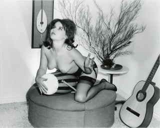 Original photograph of a beatnik woman seductively straddling a conga drum. BEATNIKS