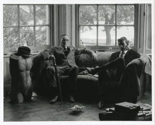 An original b&w photograph (recent print) of William Burroughs and an unidentified young man...