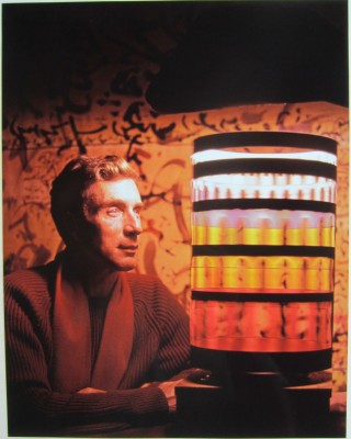 Fabulous color photograph (recent print) of Brion Gysin staring into a dream machine. Brion GYSIN, Herman LEONARD.