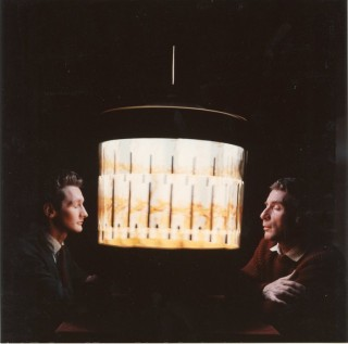 Color photograph (recent print) of Brion Gysin and Ian Sommerville staring into a dream machine....